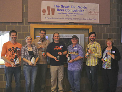 The home brewers at the Great Elk Rapids Beer Competition with celebrity judge Matt Drake of Short's Brewing Co. in the center.