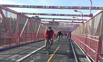 Cyclists crossing the Williamsburg Bridge to Brooklyn.